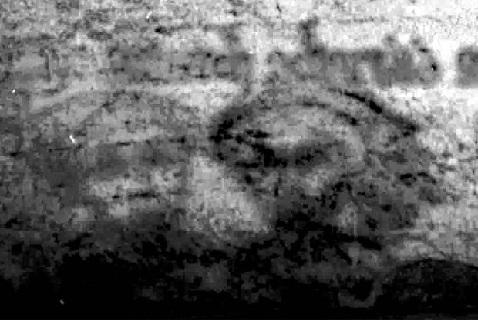 Изображение двух лиц в нижней части манускрипта