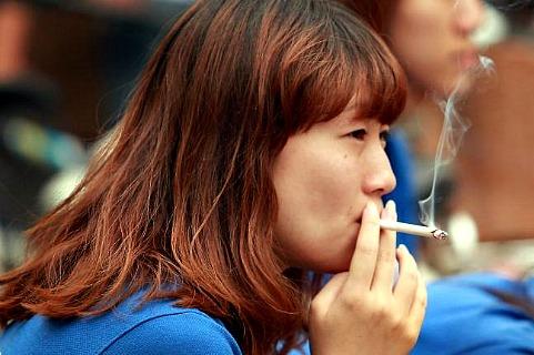 В Пекине курит четверть населения города